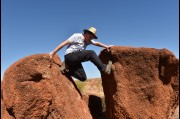 Climbing up for a shot at the Devils Marbles